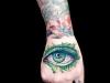 watercolor explosion eye tattoo