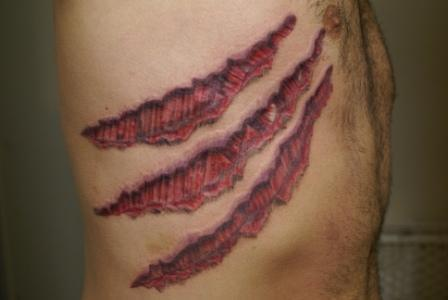 claw mark ribcage tattoo