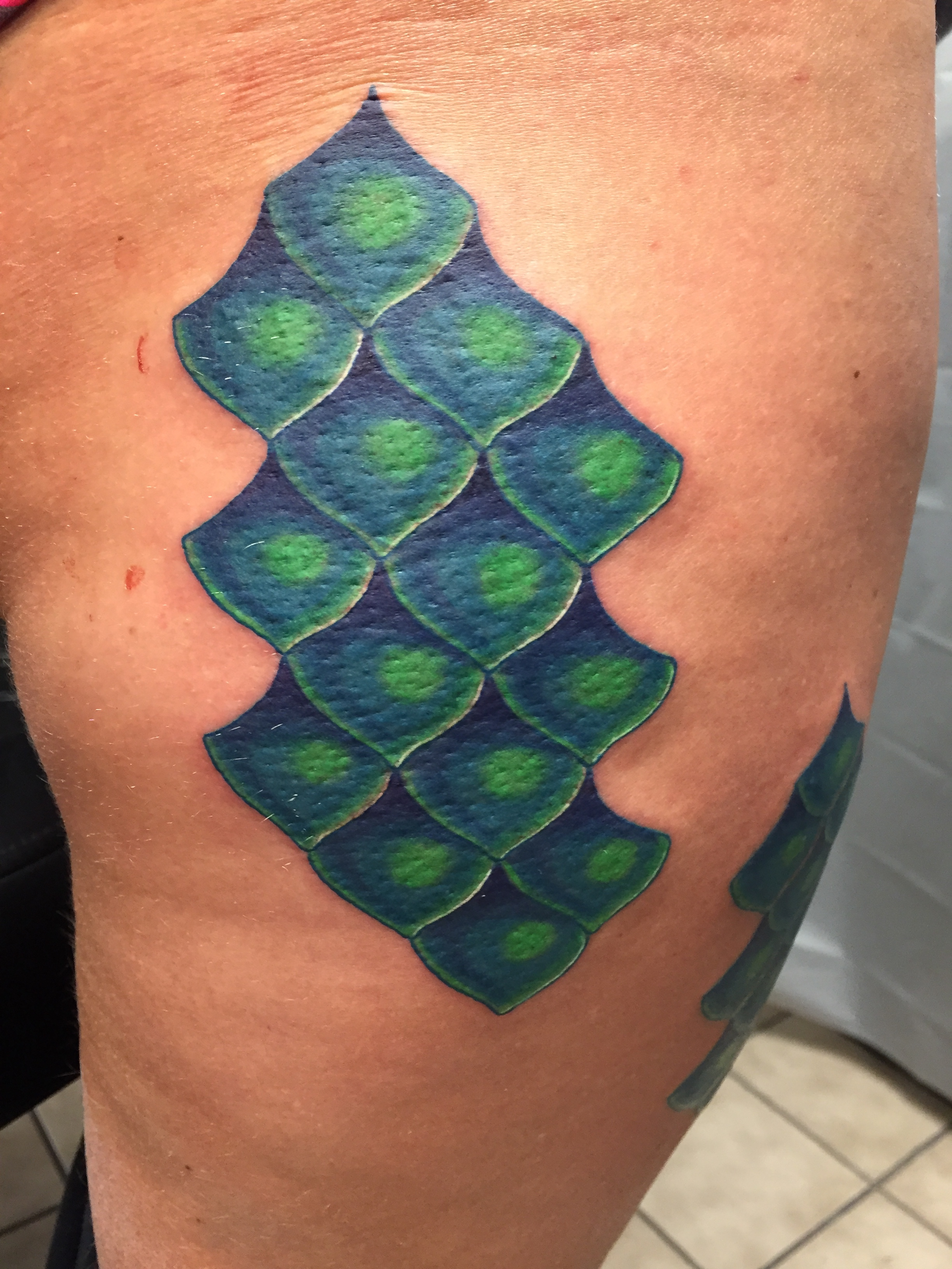 teal and green scale tattoo