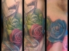 rose rib tattoo