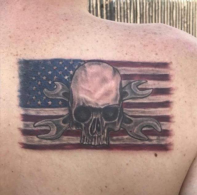 skull on an american sleeve tattoo