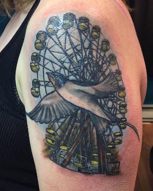 Bird and ferris wheel tattoo