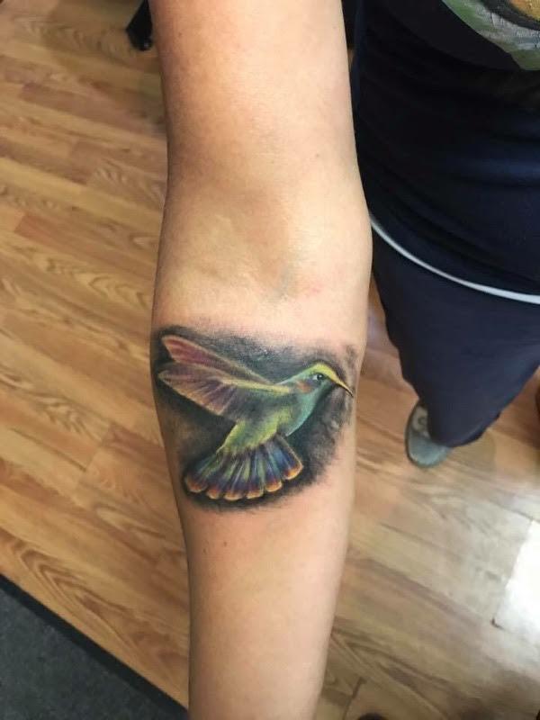 Hummingbird calf tattoo
