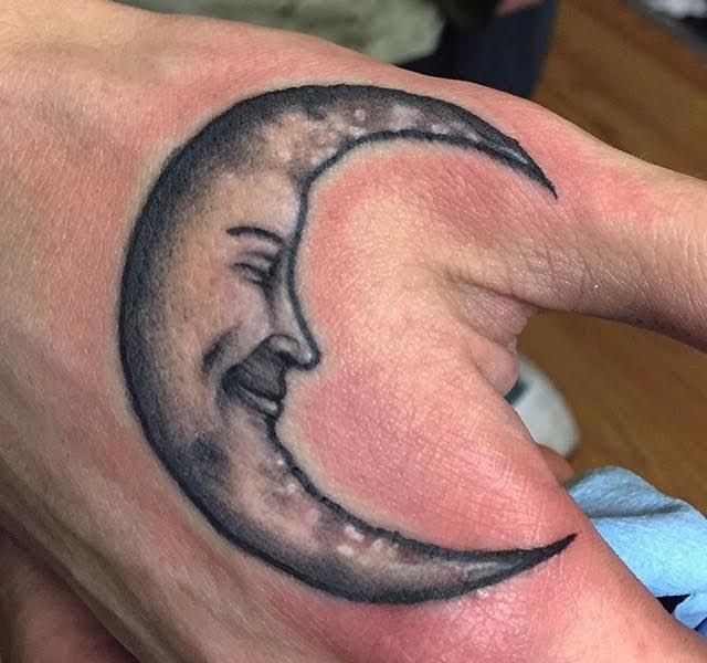 Moon on hand tattoo