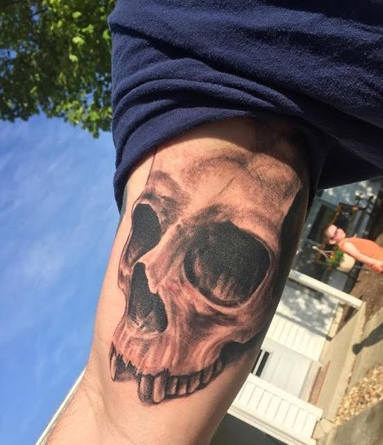 Realistic 3-D skull tattoo