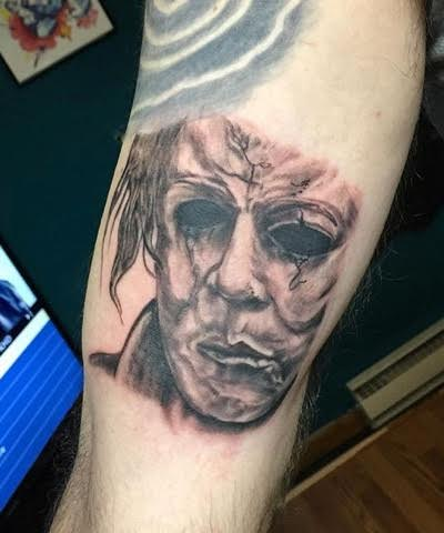 Realistic zombie face arm tattoo