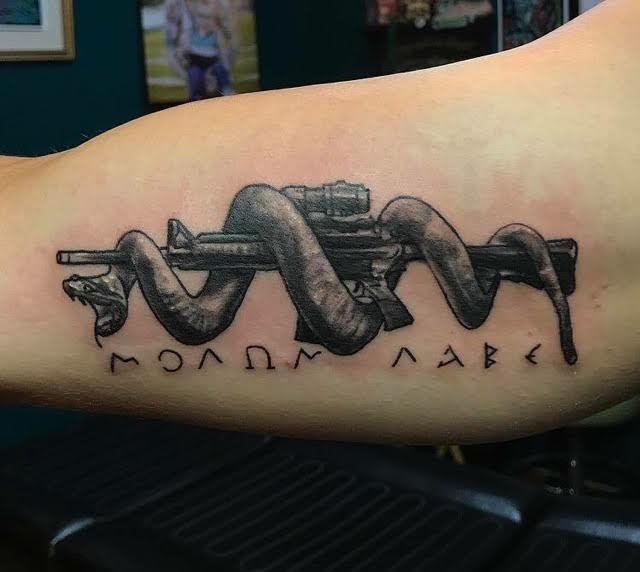Snake wrapped AK Tattoo
