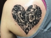 Shoulder blade roses in heart tattoo