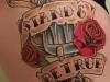 retro shield lettered tattoo